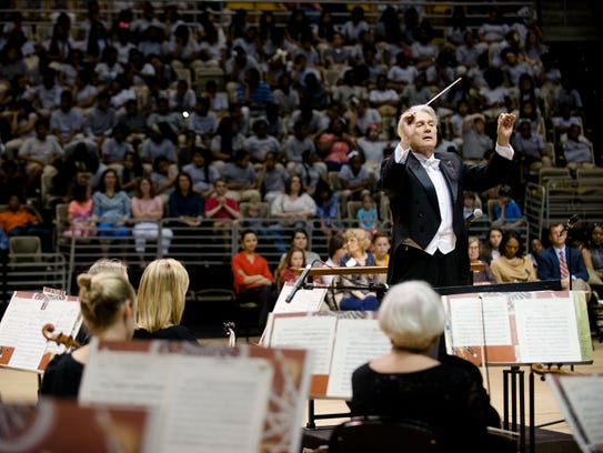 Thomas Hinds conducts during the Annual Children's