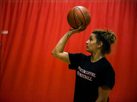 Soukaina Tracy practices shooting at the Hanover YMCA