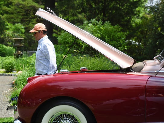 Emmanuel Molina of Rutherford walks past a 1953 Jaguar