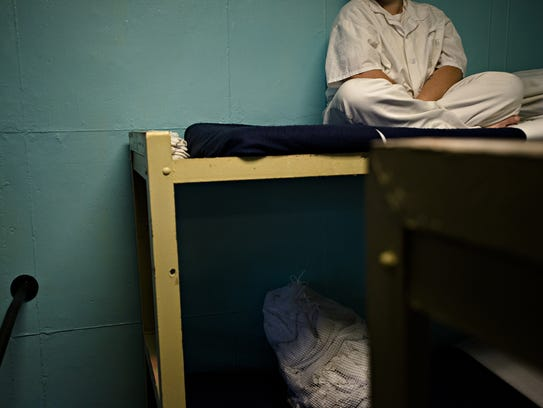 An inmate sits on her bed at Tutwiler Women's Correction