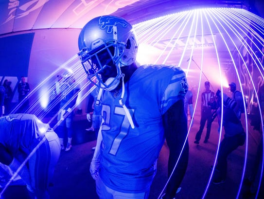 Lions safety Glover Quin stands in the tunnel at Ford