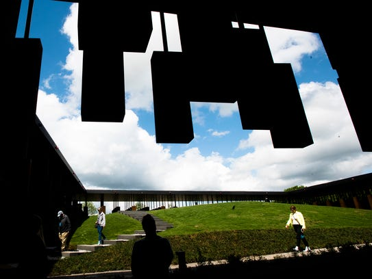 People tour EJI's National Memorial for Peace and Justice