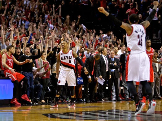 Game 6 in Portland -- Blazers 99, Rockets 98: Portland Trail Blazers guard Damian Lillard (0) reacts after hitting the game winning shot against the Houston Rockets at the Moda Center.