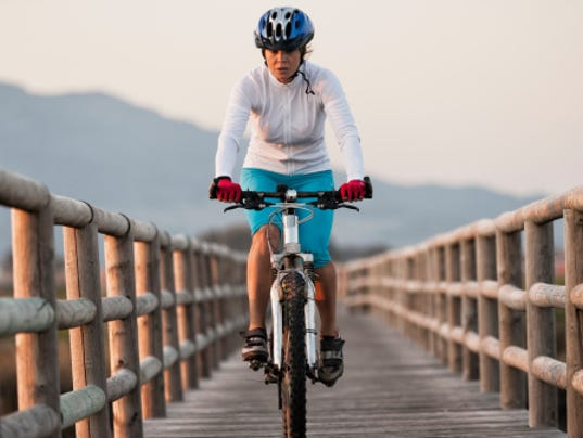 187140991-cyclist-rides-on-a-wooden-boardwalk-gettyimagess.jpg