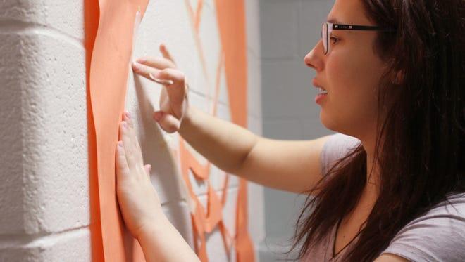 Kathleen Isenegger created murals at Howell High School that emphasize female empowerment.