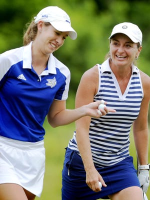 Amy Kennedy and Tori Ross, left, leave the course after Ross won the Women's York County Amateur championship at Honey Run Golf Course Wednesday, June 20, 2018. The two competed in match play for the title. Bill Kalina photo