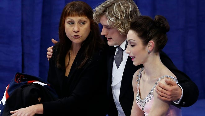 Meryl Davis and Charlie White sit next to their coach Marina Zueva (left) last month. She has them favored for gold in Sochi.
