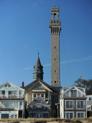 The Pilgrim Monument towers over the homes and businesses along Commercial Street in Provincetown.