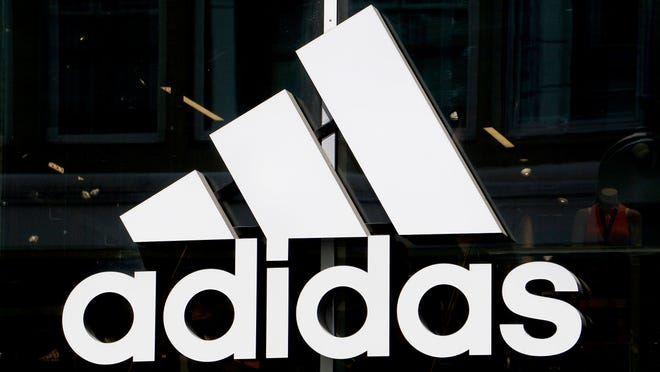 This 2019 photo shows the logo of the sports goods manufacturer Adidas in Berlin, Germany.
