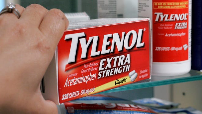 FILE PHOTO: A customer pulls a book of Tylenol from a shelf in Palo Alto, California