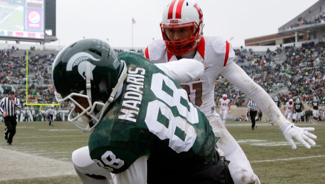 Michigan State's Monty Madaris is pushed out of bounds by Rutgers' Anthony Cioffi after a 24-yard reception on Nov. 22, 2014, in East Lansing. Madaris was listed as a starter on the spring depth chart released Tuesday.