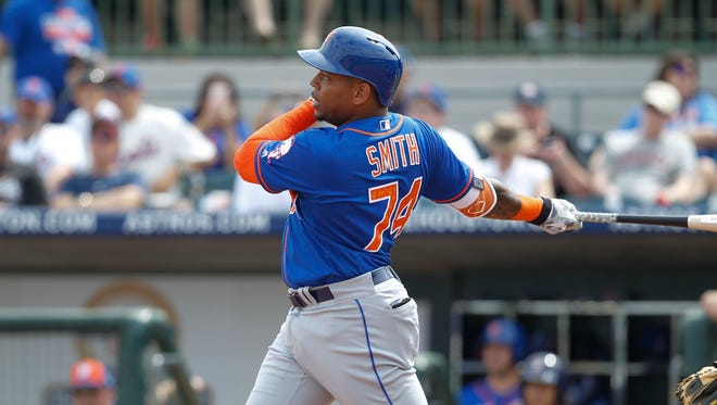 New York Mets first base prospect Dominic Smith bats during a major-league spring training game against the Houston Astros on March 5.