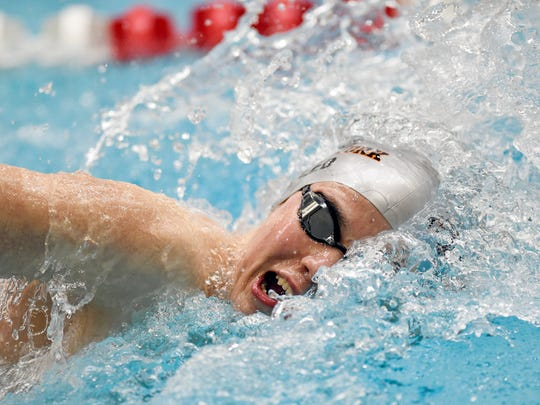 Central York's Cameron Speed swims the first leg of