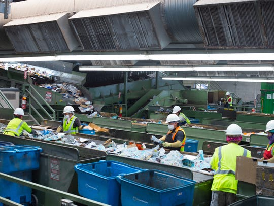Workers at the City of Phoenix Recycling Transfer Station
