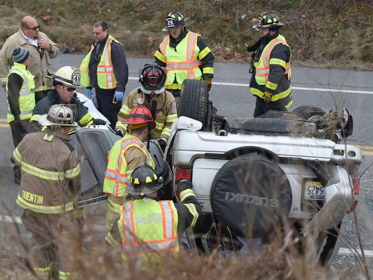 Firefighters had to free a woman trapped in her overturned vehicle after a three vehicle accident on Quentin Rd. just north of Zinns Mill Rd. Tuesday, Dec. 12.