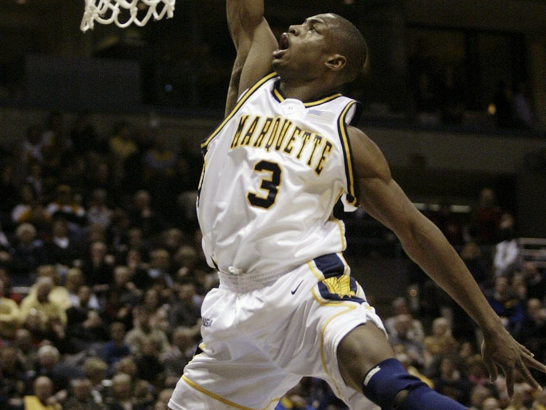 Marquette's Dwyane Wade, makes a slam dunk against South Florida in the first half of Sat. Jan. 11, 2003, game Milwaukee. (AP Photo/ Darren Hauck)