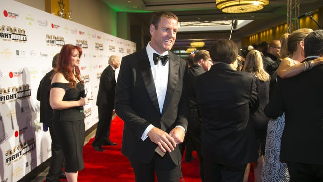 Cardinals quarterback Carson Palmer walks the red carpet during Celebrity Fight Night at the JW Marriott Desert Ridge Resort and Spa in Phoenix on Saturday, April 9, 2016.