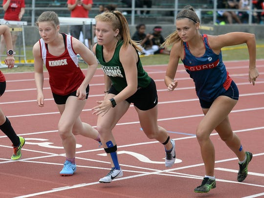 An All-Star lineup gets the jump off the line at the start of the 800-meter run during Friday's Mike Petty Memorial Track and Field Meet. From left, Nile C. Kinnick's reigning Japan and Far East cross-country champion Taryn Cates-Beier and her teammate and training partner Erin Stonebarger, Kubasaki's Elizabeth Joy, the reigning Okinawa cross-country champion, and Emma Sheedy of Guam High, the reigning Guam cross-country champion and last year's 400 meters and 800 meters champion.