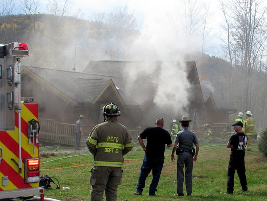 Volunteer firefighters battle a smoky house fire on Sagetown Road in the Town of Caton in 2017.