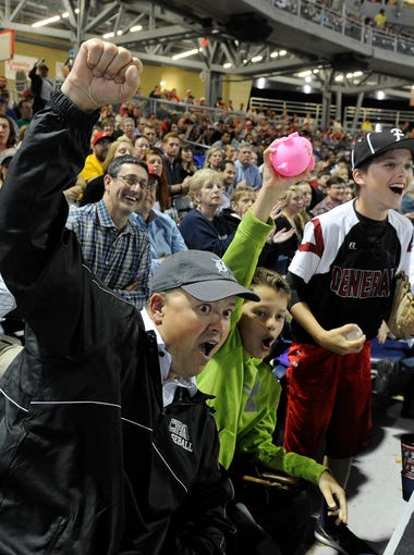 Fans Todd Sweat and sons Owen and Ford get exited in the bottom of the ninth at  First Tennessee Park o on the stadium on Friday April 17, 2015, in Nashville.
