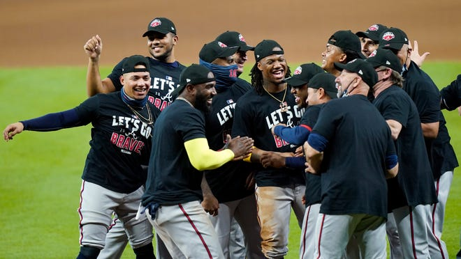 Atlanta Braves players celebrate after defeating the Miami Marlins in Game 3 of a baseball National League Division Series, Thursday, Oct. 8, 2020, in Houston.