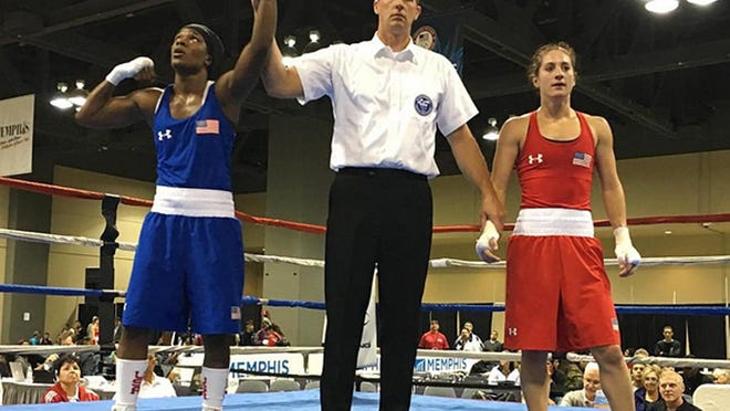 Fort Myers High School graduate Tiara Brown, left, won her first fight Monday at the U.S. Olympic Team Trials in Memphis. Tiara beat Amelia Moore with a 3-0 decision.
