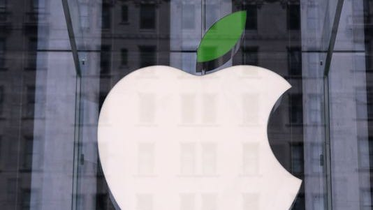 A green leaf adorns the Apple logo on Earth Day at the company's Fifth Avenue store in Midtown Manhattan on April 22 in New York.