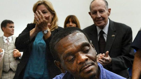 A judge exonerated Henry Lee McCollum, who spent three decades on death row, and his half-brother Leon Brown, who was serving a life sentence. A standing ovation followed.