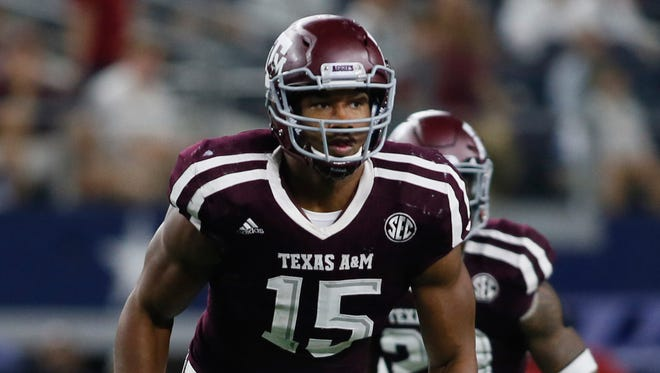 Texas A&M Aggies defensive lineman Myles Garrett (15) in game action against the Arkansas Razorbacks at AT&T Stadium.