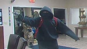 This Dec. 9, 2016 surveillance photo shows one of five suspects that robbed the Bank of Delmarva on Eastern Shore Drive.