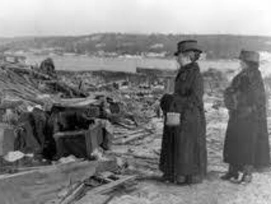 Women look at the devastation that followed the explosion,