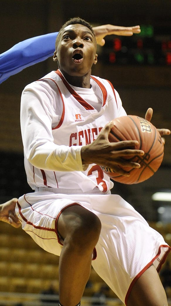 Lee's Roderic Scott (3) goes to the basket against