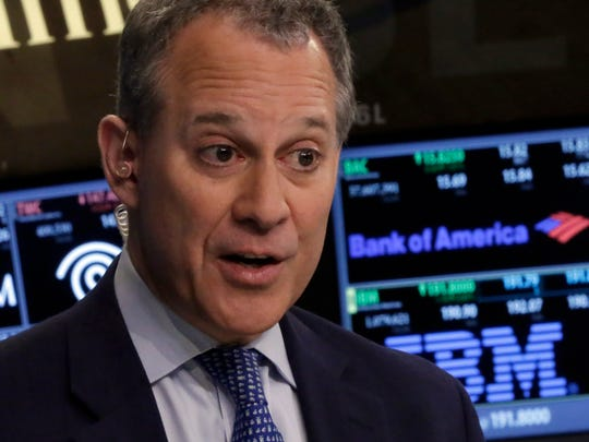 New York Attorney General Eric Schneiderman is interviewed on the floor of the New York Stock Exchange last week about New York's $800 million share of a national $16.65 billion settlement with Bank of America over its role in the sale of mortgage-backed securities in the run-up to the financial crisis.