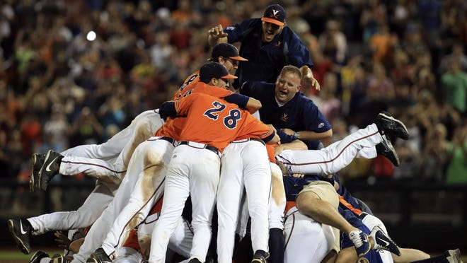 Jun 24, 2015; Omaha, NE, USA; The Virginia Cavaliers celebrate after defeating the Vanderbilt Commodores in game three of the College World Series Final at TD Ameritrade Park. Virginia defeated Vanderbilt 4-2 to win the College World Series. Mandatory Credit: Bruce Thorson-USA TODAY Sports