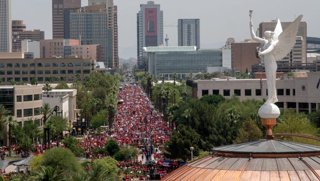 Parents, students, and educators supporting #RedForEd walk towards the Arizona State Capitol in Phoenix  on Thursday April 26, 2018