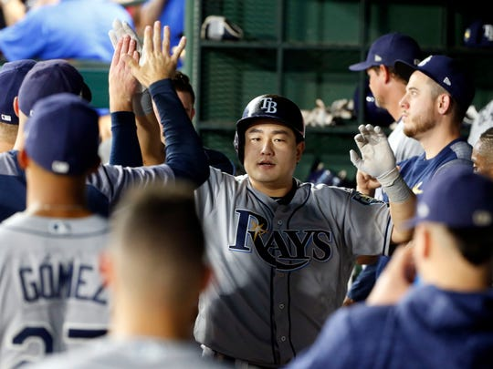Tampa Bay Rays' Ji-Man Choi, center, is congratulated by teammates after a solo home run against the Texas Rangers during the sixth inning of a baseball game Monday, Sept. 17, 2018, in Arlington, Texas. (AP Photo/Michael Ainsworth)