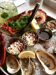 A platter of East and West Coast oysters and lobster cocktail with seaweed salad at Hudson Farmer & the Fish in Sleepy Hollow.