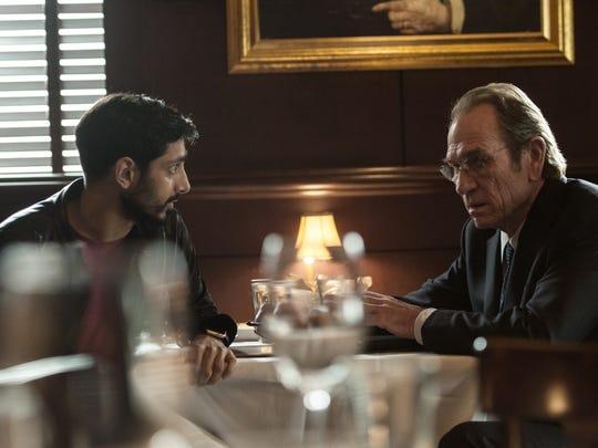 "Aaron Kalloor (Riz Ahmed) meets with the director of the CA  (Tommy Lee Jones) in ""Jason Bourne."""
