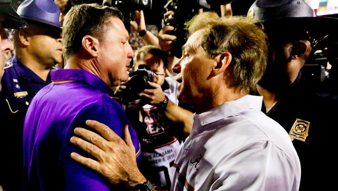 Coaches Ed Orgeron of LSU and Nick Saban of Alabama shake hands after the Tigers' 10-0 loss to then No. 1 Alabama in a 2016 game in Tiger Stadium.