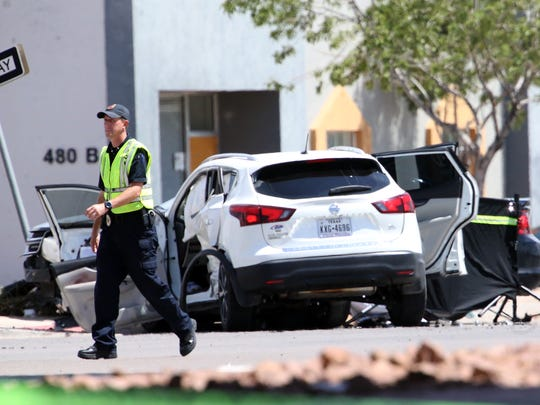 El Paso police personnel work the scene of a traffic accident at Pan American Drive and South Americas Avenue Thursday afternoon.