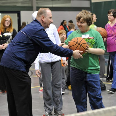 Warsaw Elementary School Principal Frank Polen helps