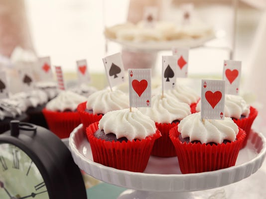 Red velvet cupcakes with playing cards toppers, Alice in wonderland
