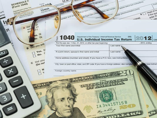 Tax form with pen, calculator, dollar banknote , and glasses tax