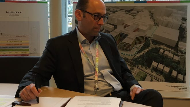 Michael Fisher, chief executive officer of Cincinnati Children's Hospital Medical Center, talks with The Enquirer about the facility's planned expansion into Avondale.