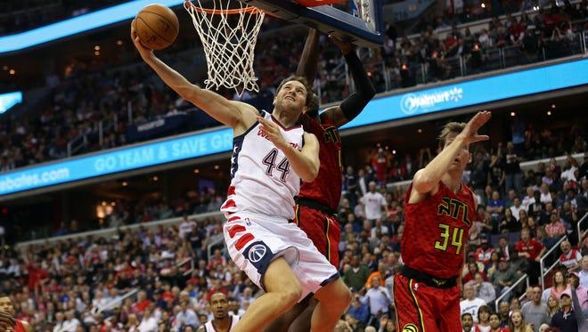 Washington Wizards guard Bojan Bogdanovic (44) shoots the ball as Atlanta Hawks forward Paul Millsap (4) defends in the fourth quarter in Game 5.