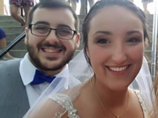 Ted Peck and Danielle Crone pose on their wedding day