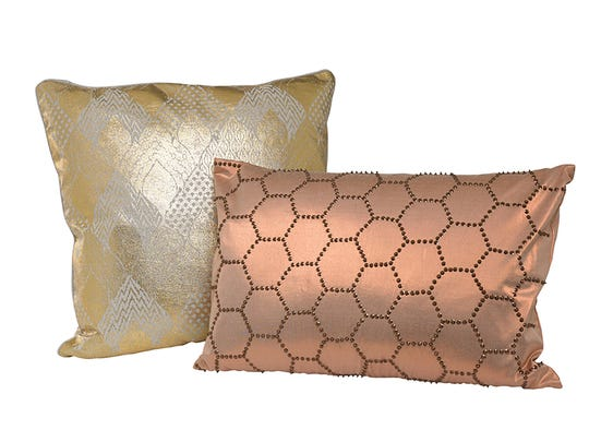 HomeGoods.com offers this pair of pillows in rose gold and a burnished metallic, a color trend in pillows, throws and other accessories this fall.
