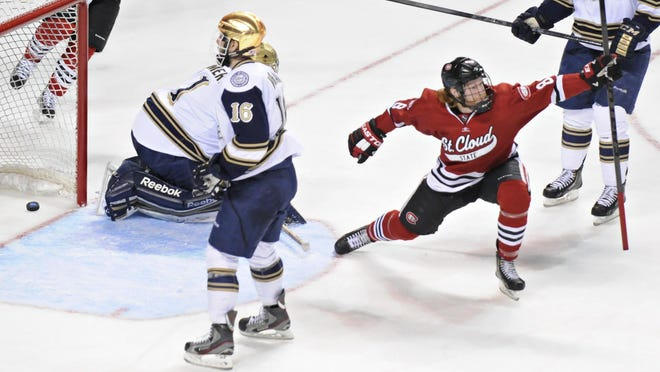 St. Cloud State's Cory Thorson (right) celebrates his goal against Notre Dame during the NCAA Division I Midwest Regional semifinals March 30, 2013, at the Huntington Center in Toledo, Ohio.