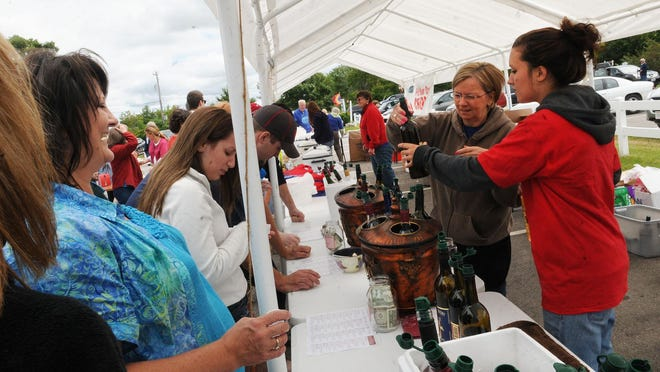 Wine samples, including nonalcoholic ones, are offered at Summer Harvest Cherry Fest at Lautenbach's Orchard Country Winery & Market.