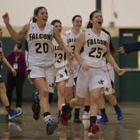 Taylor Langan and Victoria Pietrazskiewicz celebrate Jefferson's overtime victory in a Morris County Tournament quarterfinal.